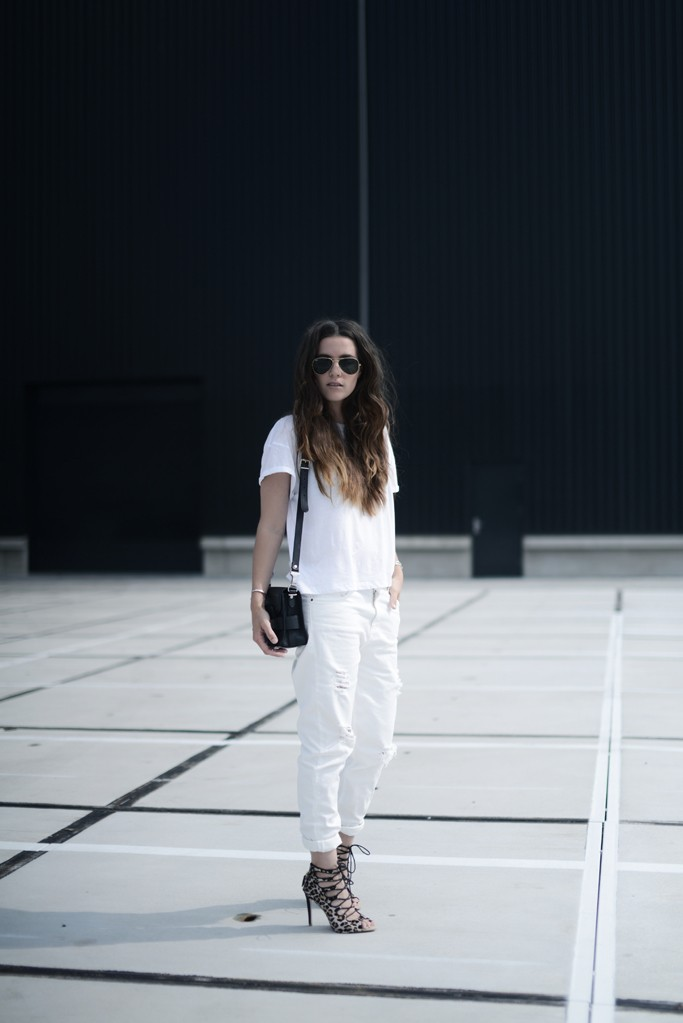 Cindy Van Der Heyden is wearing ripped white jeans from Zara, white top and leopard heels and a PS11 bag
