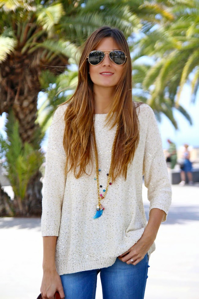 Marianela is wearing a white sequin top from Mango and jeans from Stradivarius