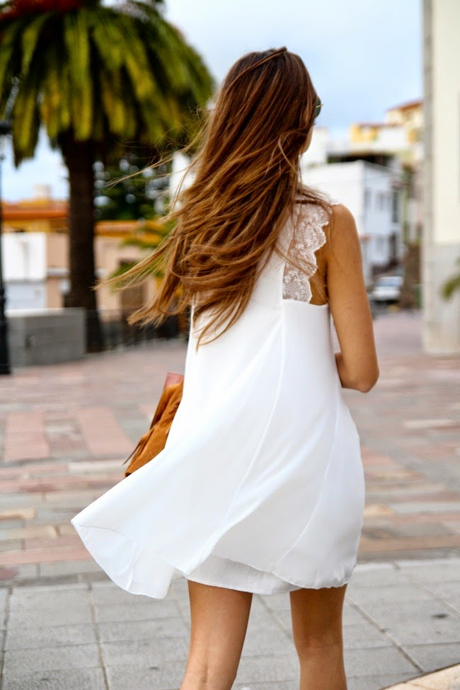 Marianela Is Wearing A White Dress With Lace Trims From TFNC London