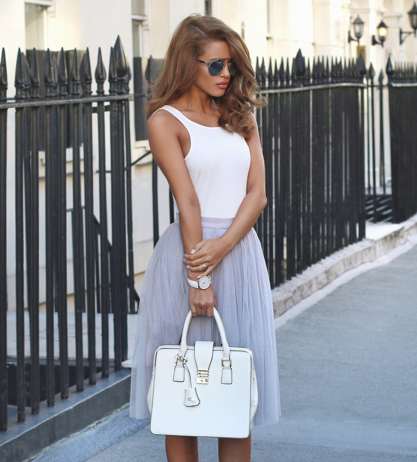 Nada Adelle rocks this Tulle skirt by pairing it with a simple white bodysuit and a statement box bag. Bodysuit: Missguided, Skirt: Lydia Bright.