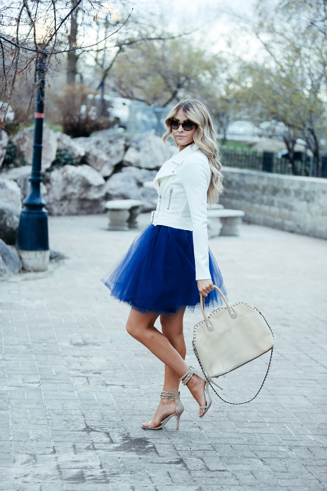 Add some edge to your tulle skirt outfit by branching out in your colour scheme and going for a shade of cool blue like Cara Loren! This beautiful royal blue looks fresh and original worn with a cute white leather jacket and neutral heels. Dress: Nha Khanh, Jacket: Windsor.