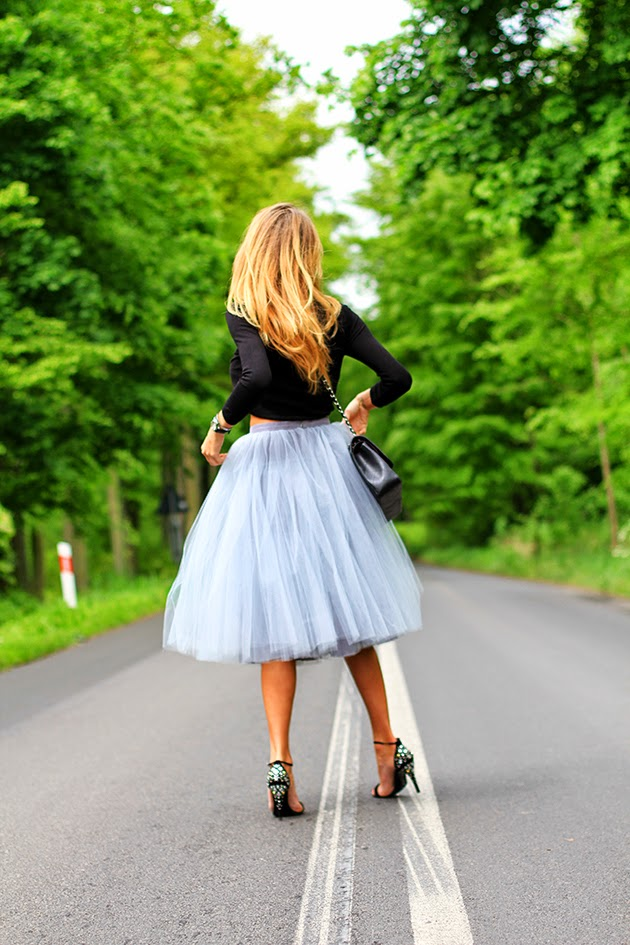 Magdalena Is Wearing A Tulle Skirt From Fanfaronada, Shoes From Karen Millen And Bag From Chanel
