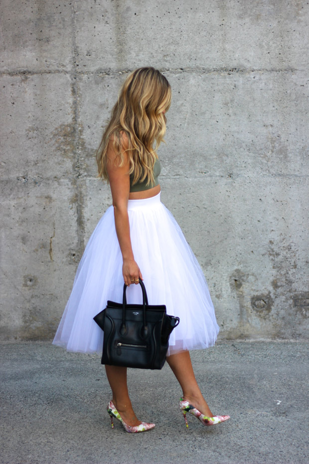 Cara McLeay is wearing an olive top from American Eagle, white tulle skirt from Windsor, bag from Celine and floral pumps from Stuart Weitzman