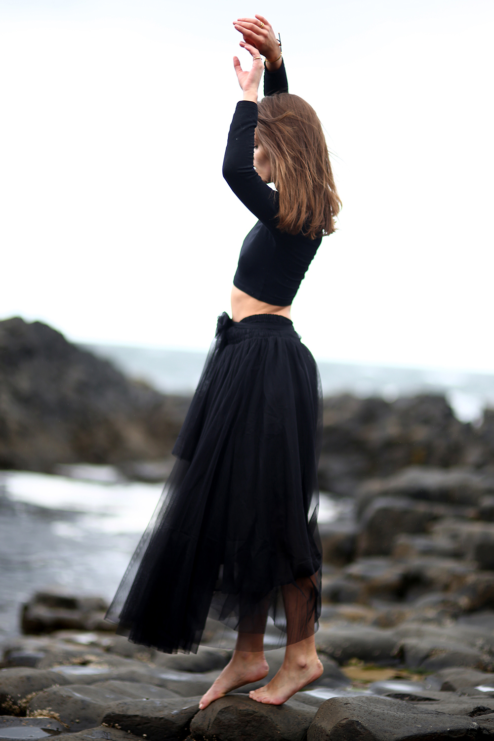 Anouska Proetta Brandon is wearing all black crop top and tulle skirt