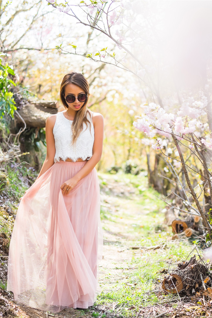 Kim Le is wearing a white lace crop top and pink tulle skirt from Morning Lavender