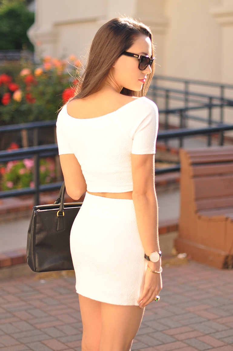 HapaTime Is Wearing Ohvola Embossed White White Skirt And Top, Bag From Prada And Shoes From Steve Madden