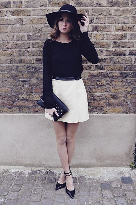 Millie Mackintosh Wearing A White Skirt And Black Top From Super Trash, Shoes From Office, Clutch From Mahe And The Hat Is Polo From Ralph Lauren