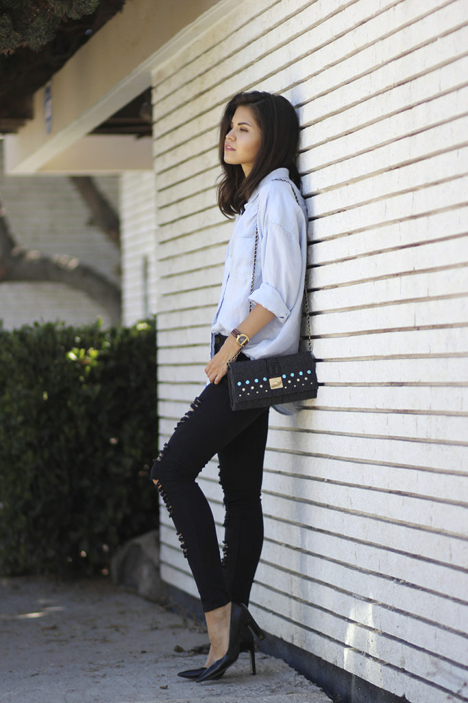 Adriana Gastelum is wearing a blue linen boyfriend shirt from Gap, black ripped jeans from SammyDress, clutch from V37 and shoes from Coach