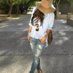 Andee Layne Is Wearing A Boyfriend Shirt From Forever 21, Distressed Skinny Jeans From Hudson, Sandals From Dolce Vita, Hat From Janessa Leone And Mirrored Sunglasses From Dita