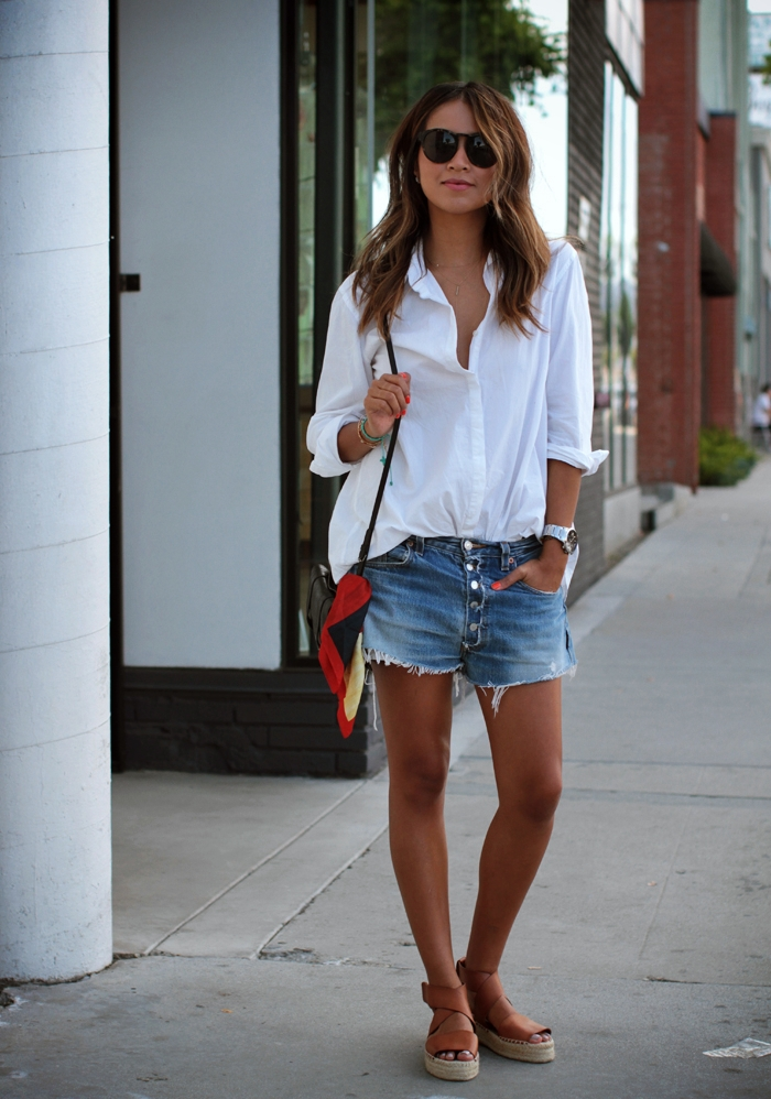 Julie Sarinana Is Wearing A White Boyfriend Shirt From Silence & Noise, Denim Shorts From Levi's, Espradilles From Vince, Bag From Proenza Schouler, Scarf From Christian Dior, And The Sunglasses Are From Raen