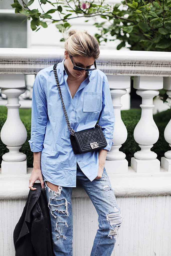 Camille Charriere is wearing a leather jacket from FWSS, blue boyfriend shirt from Rika, ripped denim jeans from Zara and the bag is from Chanel