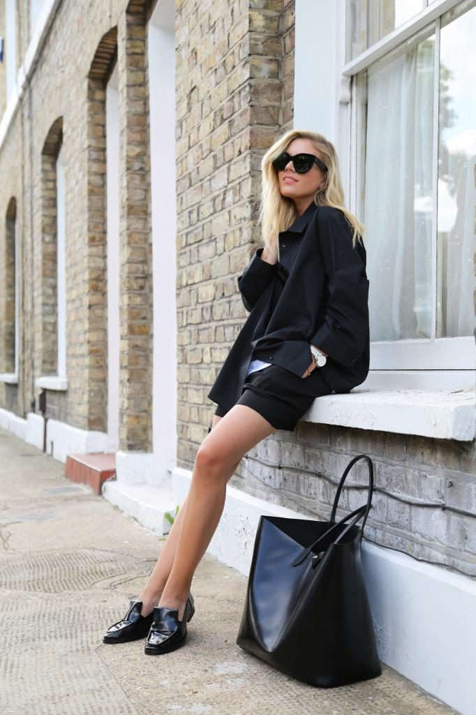Isabella Thordsen is wearing a black oversized boyfriend shirt from ASOS