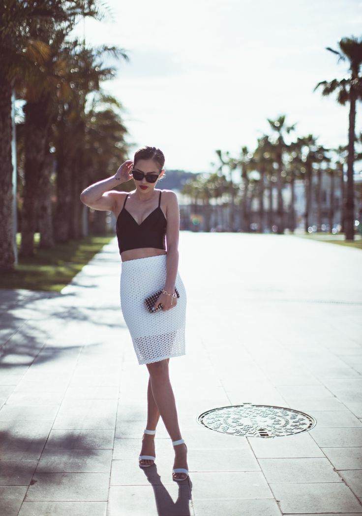 Kenza Zouiten Is Wearing Black Crop Top And Eyelet Skirt From Chicy, Shoes From Bikbok, Sunglasses From Prada And Clutch From Zara
