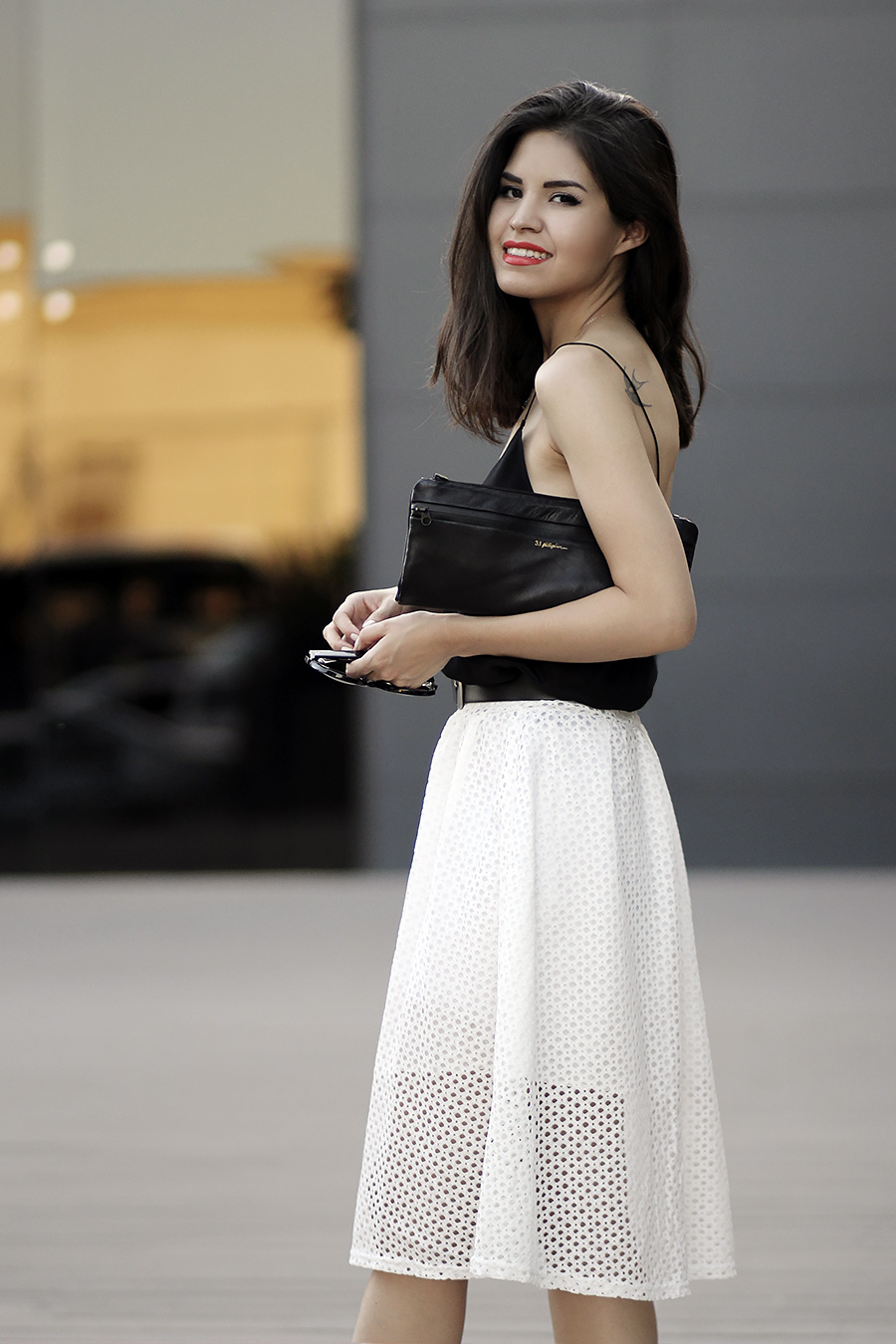 Adriana Gastélum Is Wearing A White Eyelet Midi Skirt From Sheinside, Black Top From Cami NYC And Neoprene Clutch From Philip Lim