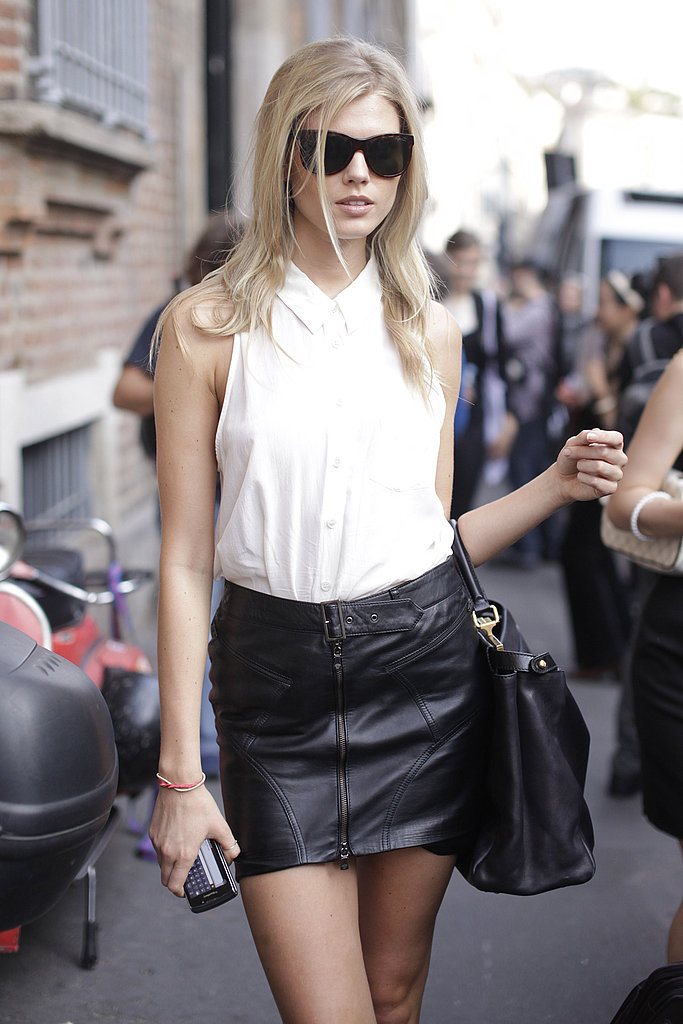 Maryna Linchuk In White Top And Black Leather Mini Skirt. Photography By Greg Kessler