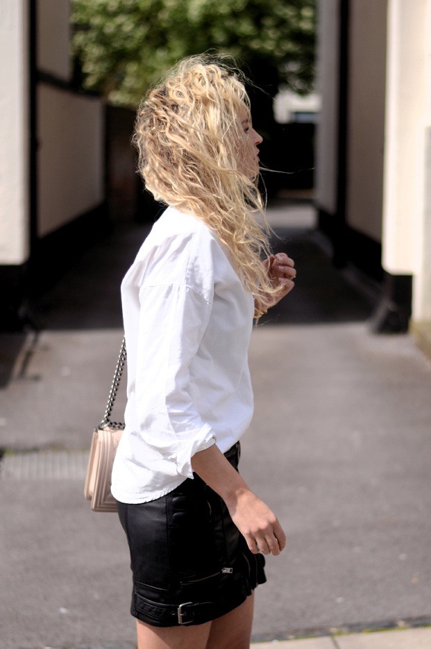 Anouk Yve Is Wearing A White Shirt From Comma And A Black Mini Leather Skirt From All Saints