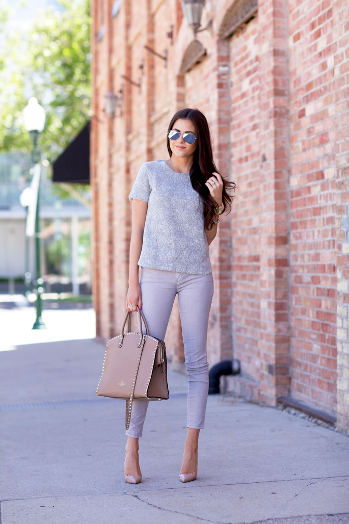 Rachel Parcell Is Wearing Mirrored Sunglasses By Rayban, Top From J. Crew, Trousers By Current/Elliott, Bag From Valentino And Shoes From Christian Loboutin