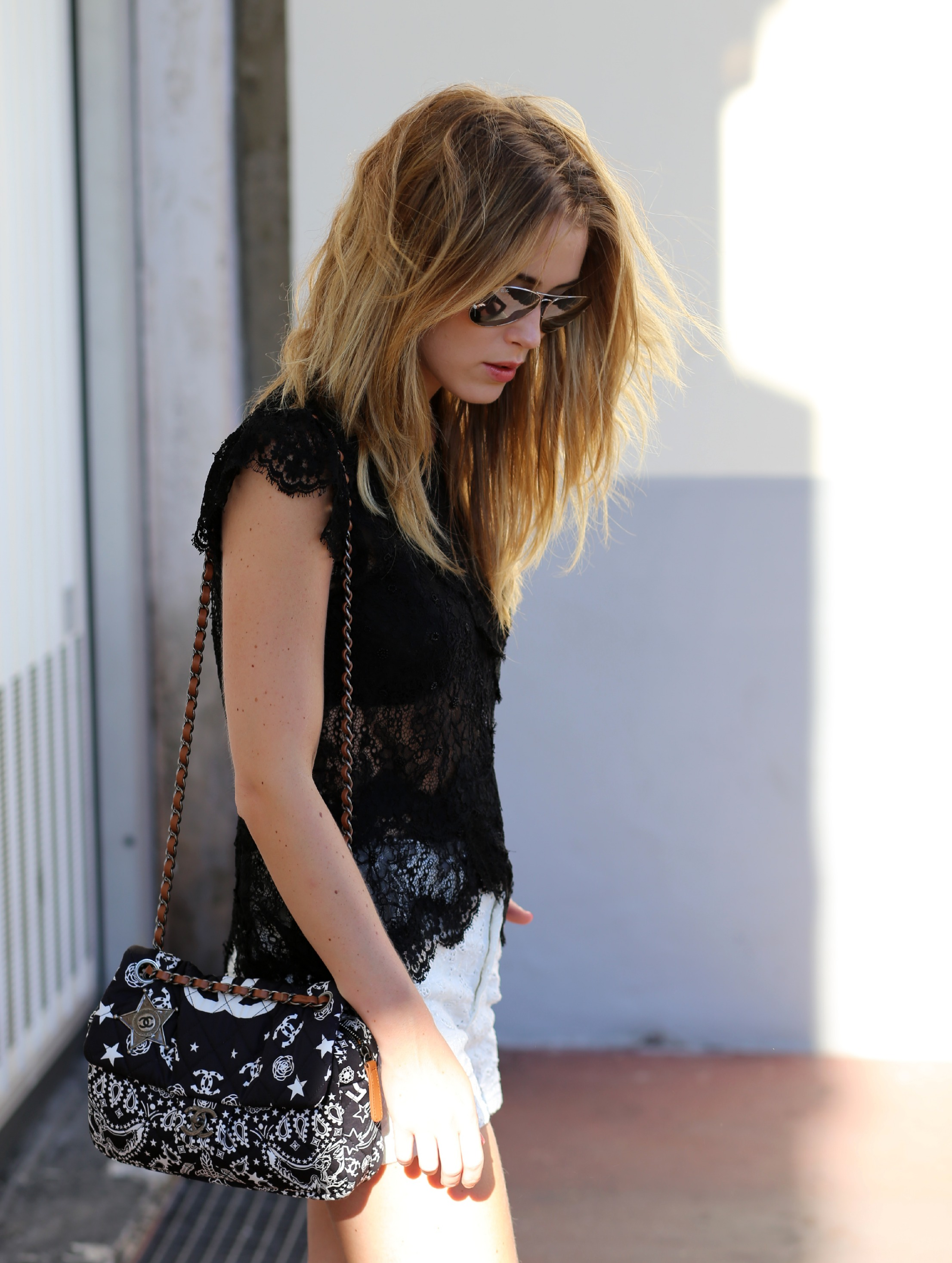Annabel Rosendahl is wearing a lace top and shorts from Isabel Marant, bag from Chanel and the mirrored sunglasses are from Rayban