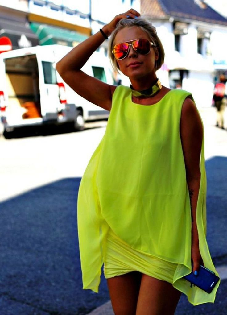 Mirrored sunglasses, neon dress unknown blogger/photographer