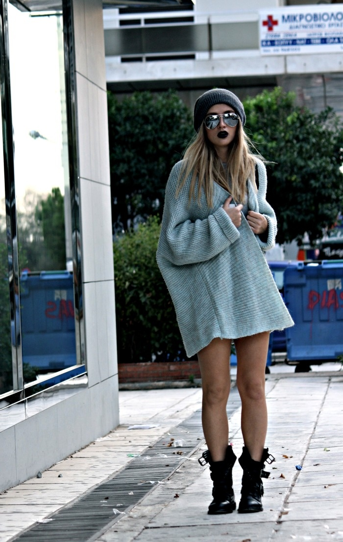 Fashionable J Wearing Mirrored Sunglasses, Oversized Charcoal Grey Sweater And Chunky Biker Boots