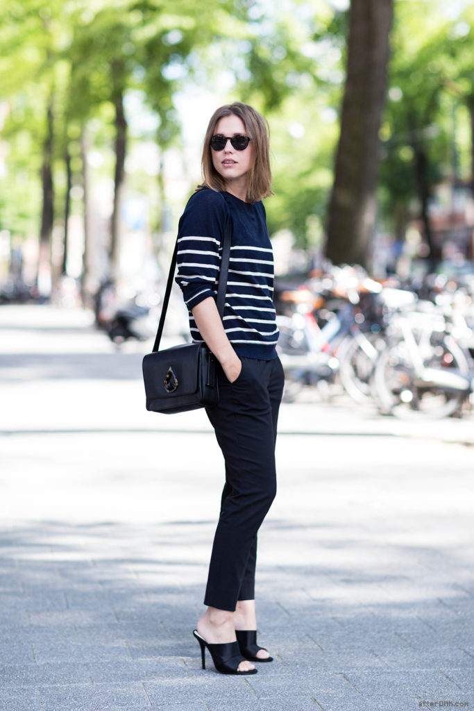 Sabrina Meijer Is Wearing A Striped Top From Ganni, Trousers From Acne Studios, Black Mules From Zara, Bag From Kenzo And Sunglasses From Bottega Veneta