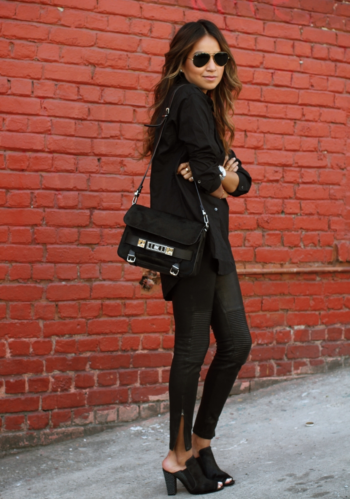 Julie Sarinana Is Wearing Black Mules From 3.1 Philip Lim, A Black Shirt From Madewell, Leather Skinnies From J. Brand And The Bag Is From Proenza Schouler