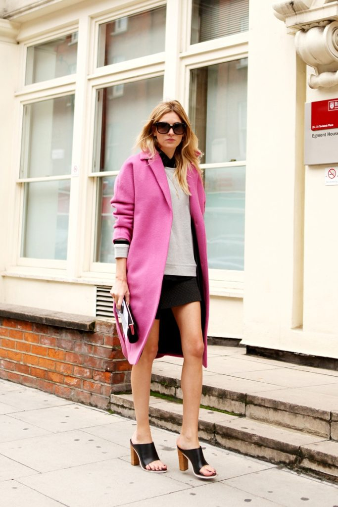 Camille Charrière Is Wearing Mules And SweatShirt From Tibi, A Pink Coat From Malene Birger, Skirt From Zara, Clutch From Jimmy Choo