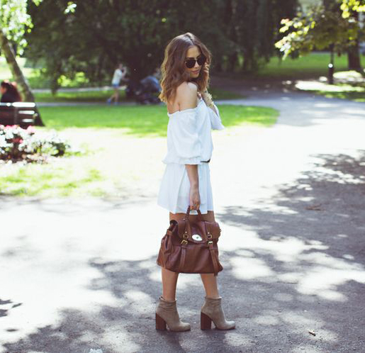 Kenza Zouiten is wearing a white off the shoulder summer dress from Nelly, shoes from Jeffrey Campbell and a bag from Mulberry