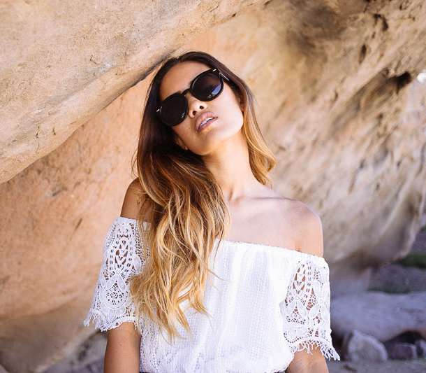 Jill Wallace is wearing a white off the shoulder dress from Boutique To You