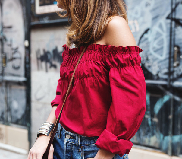 Collage Vintage is wearing a red off the shoulder top from Zara