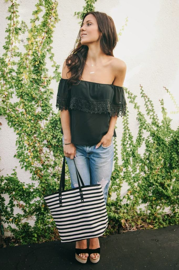 Andee Layne is wearing a black off the shoulder top and a striped tote from Windsor, jeans from Joe Jean's, and wedges from TopShop
