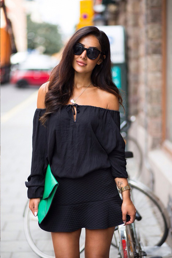 Sharareh Sophia is wearing a black off the shoulder top and skirt from BikBok, bag from Aahlens