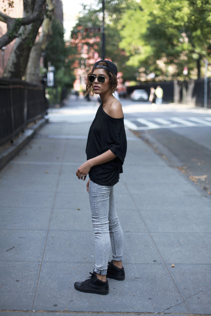 Christina Caradona is wearing a black off the shoulder T-shirt from Sandro, jeans from Express, hat from Alex and Chloe and the shoes are from Acne