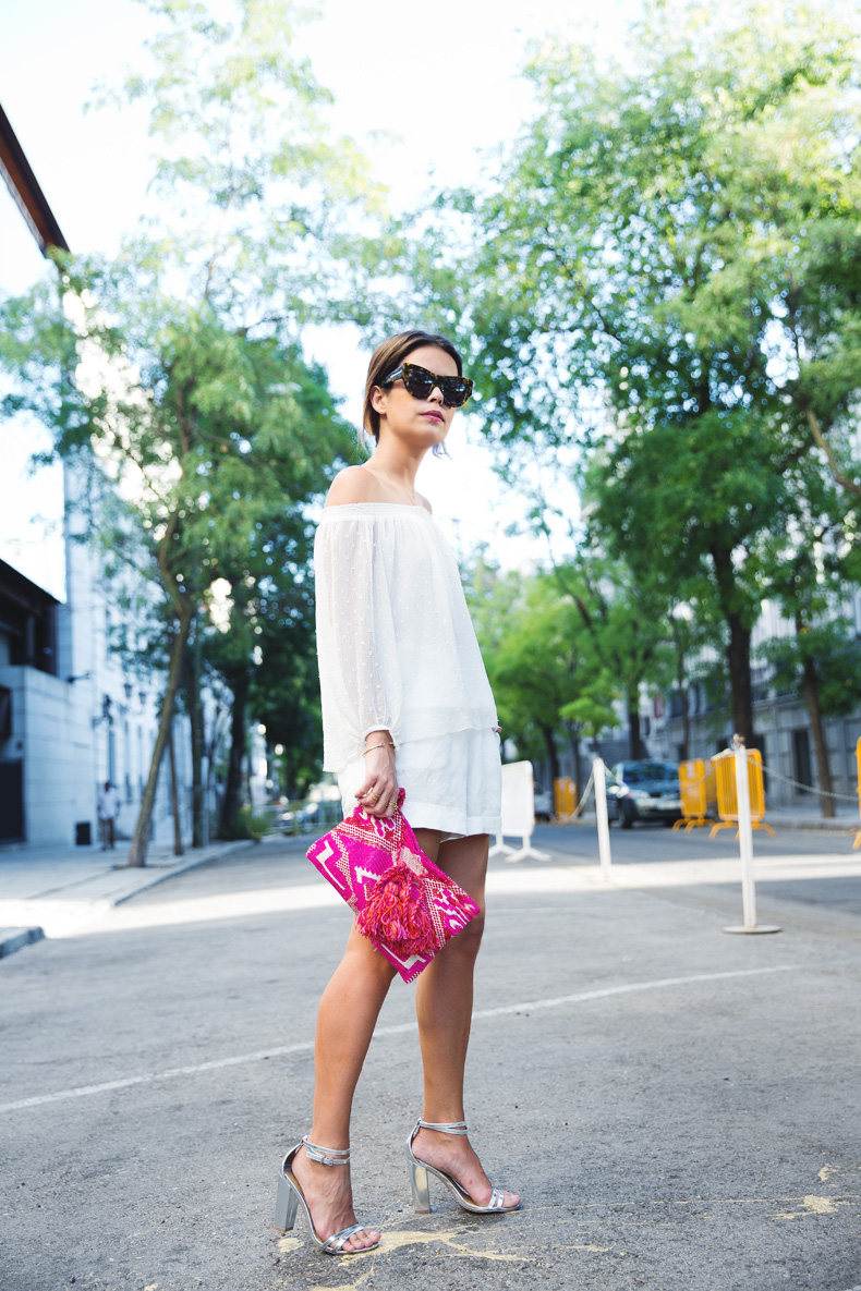 Sara Escudero is wearing an off the shoulder top from Mango, shorts from Zara, shoes from Asos, clutch from Oysho and sunglasses from Karen Walker