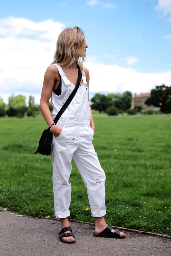 Lucy Williams is wearing white denim overalls and vest from TopShop and sandals from Birkenstrock