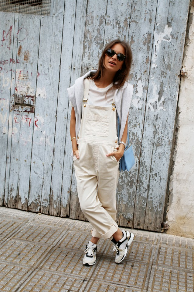 Lizzy Van Der Light is wearing white denim dungarees/overalls from Ganni, jumper from Isabel Marant, T-Shirt from H&M shoes from Chanel and a bag from Céline