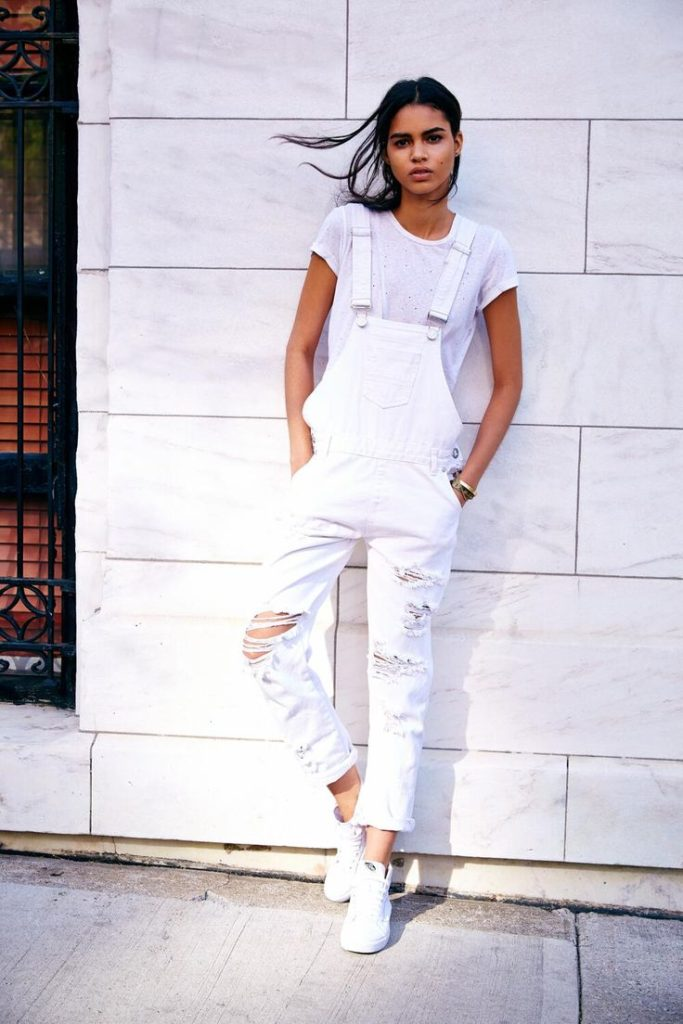 White distressed denim overalls from Urban Outfitters