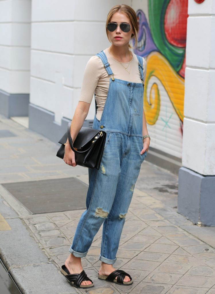 Annabel Rosendahl is wearing a denim overall from Current/Elliott, sand coloured top from FWSS, sandals from Isabel Marant and sunglasses from Rayban