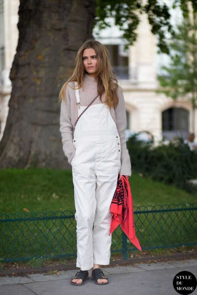 Caroline Brasch Nielsen is wearing white denim overalls and a beige sweater Via Style Du Monde