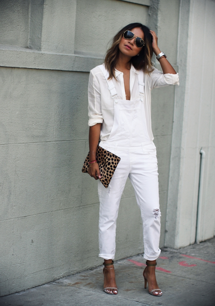 Julie Sarinana is wearing a white overalls and shirt from Paige Denim, clutch from Clare Vivier and shoes from Anine Bing