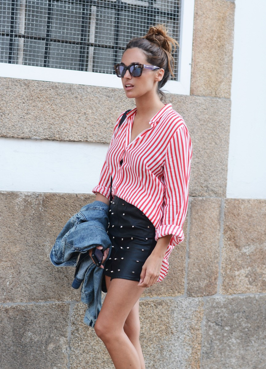 Stella Wants To Die is wearing a red and white striped shirt from Zara, studded skirt from Ewigem and mirror sunglasses from Fendi