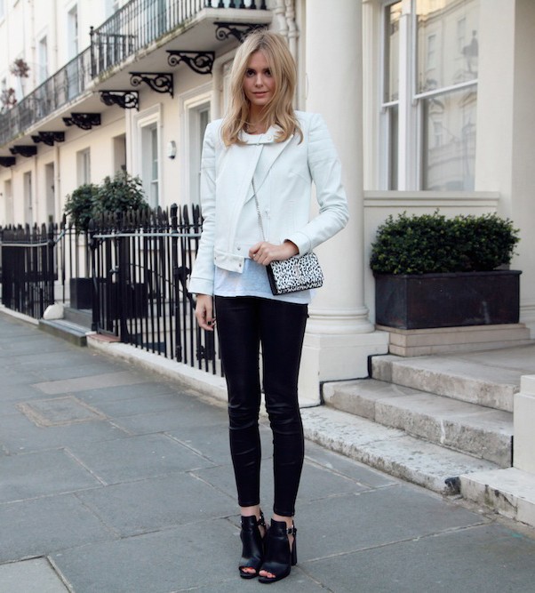 Jessica Stein is wearing a white leather jacket from Camilla And Mark, leather pants from J. Brand, t-shirt designed by isabel Marant, shoes from Zara and a bag from Saint Laurent