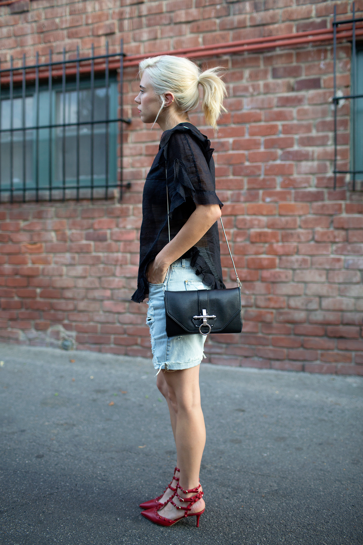 Courtney Trop is wearing a lace top from Isabel Marant, shorts from Res Denim, shoes from Valentino and bag from Givenchy