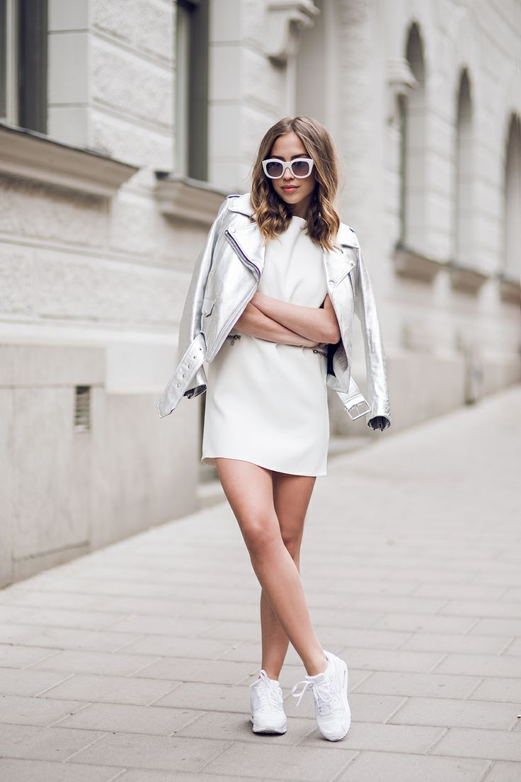 Kenza Zouiten is wearing a silver leather jacket from Acne, white dress from Zara, trainers from Nike, (Air Max 90's), and sunglasses from Le Specs