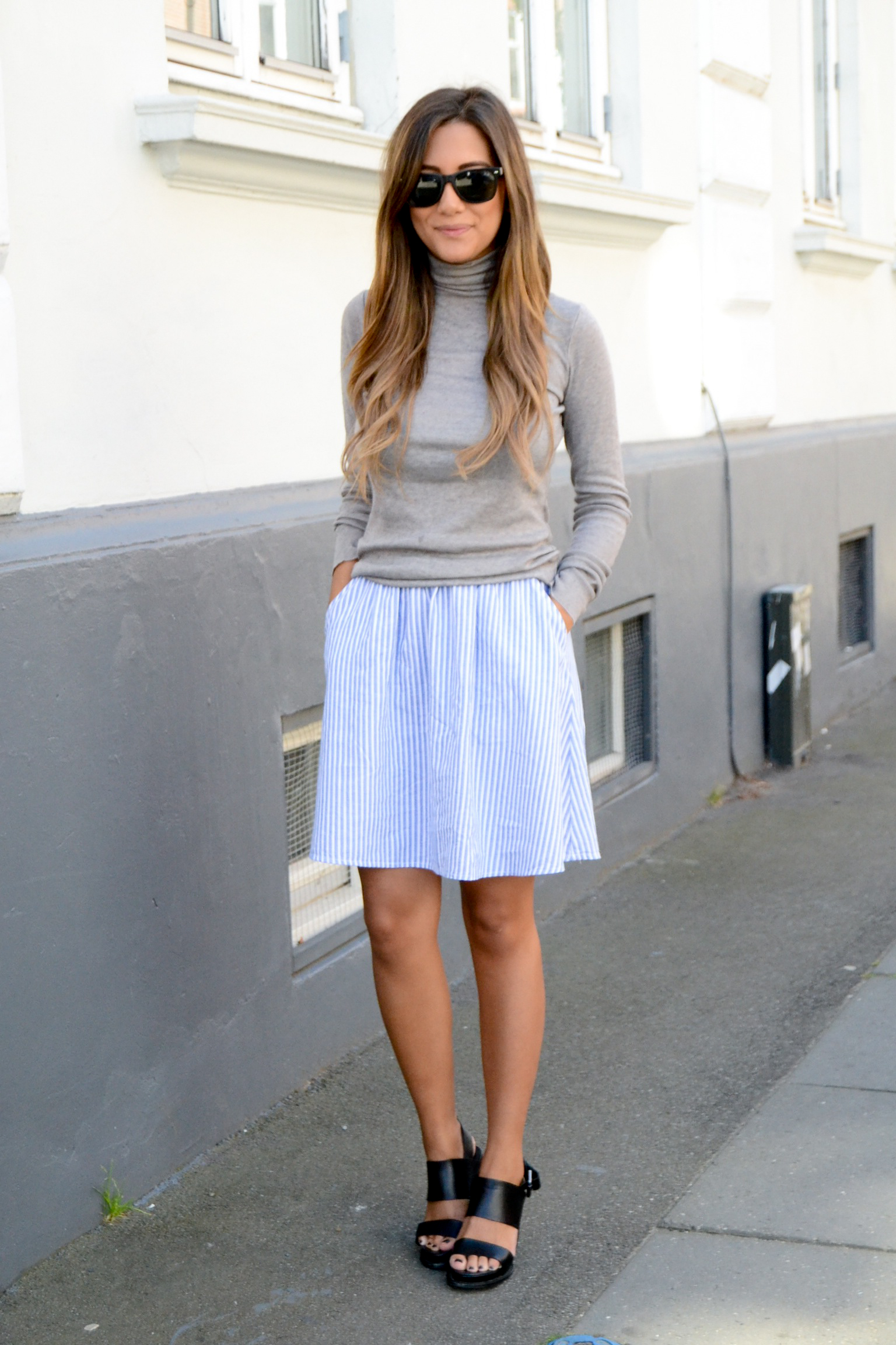 Michelle Nielsen is wearing grey turtleneck from FrontRow, striped skirt from Monki and shoes from & Other Stories