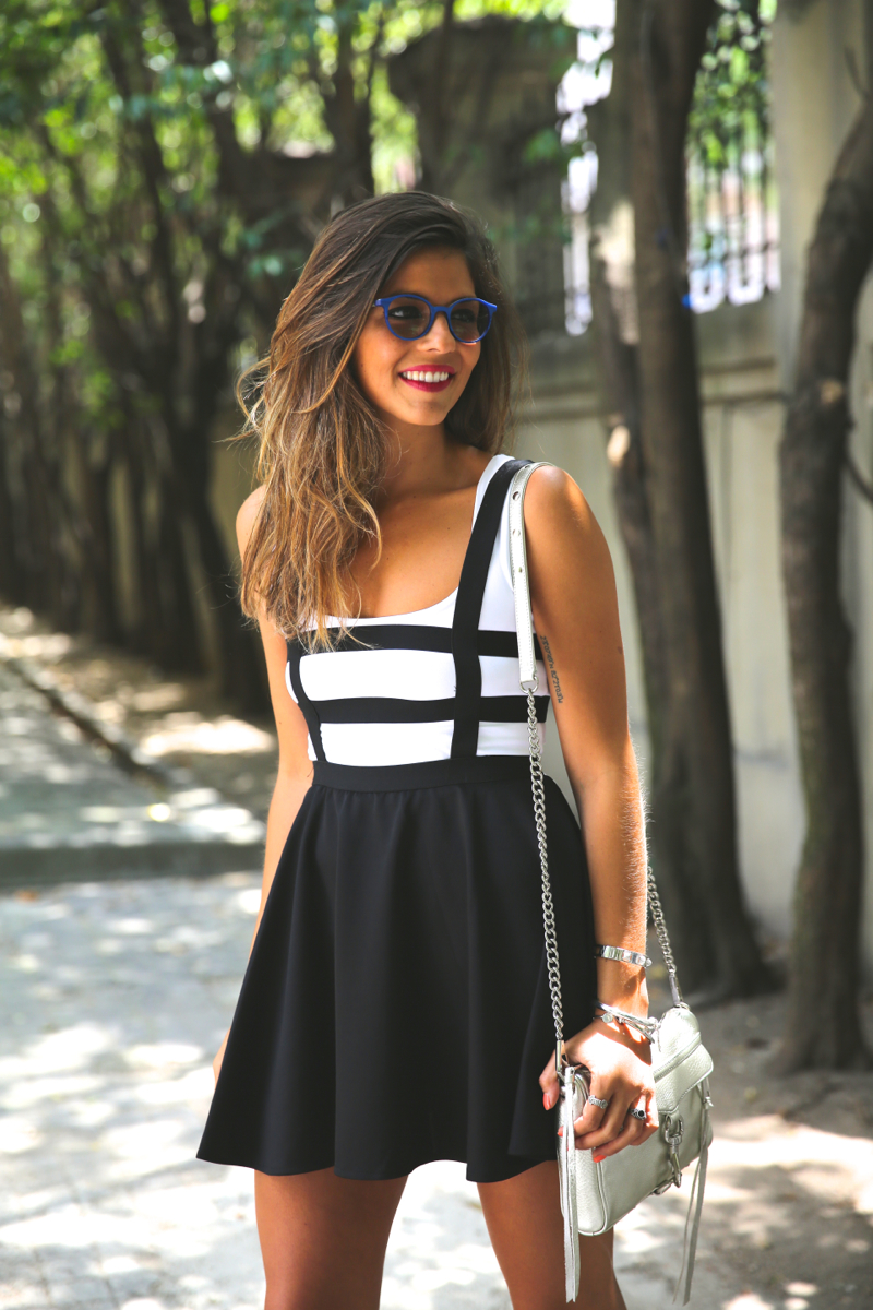 Natalia Cabezas is wearing a striped dress from Choies, white T-shirt from H&M, bag from Rebecca Minkoff and blue sunglasses from Ethnicity Barcelona