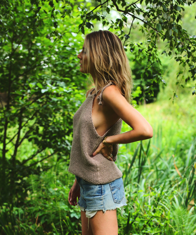 Lucy Williams is wearing an uma top from Wool & The Gang, cut-off denim shorts from Levi's
