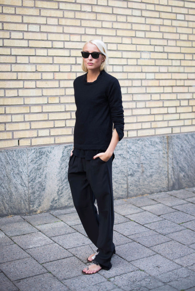 Ellen Claesson is wearing layers and all black. Cashmere top from Davida, shirt from Filippa K, trousers from Hunky Dory and sandals from Atp Atelier