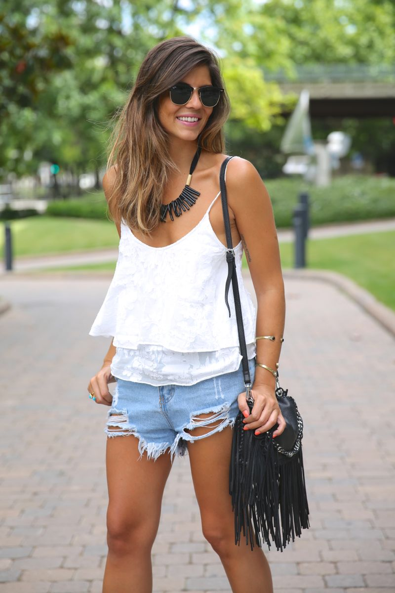 Natalia Cabezas is wearing a white layered top and fringed bag from Zara, and shorts from Sheinside