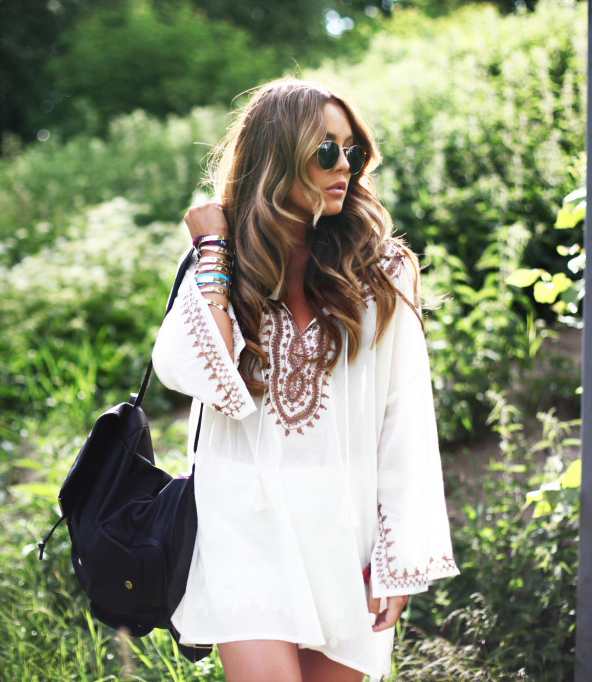 Angela Blick is wearing a white boho tunic from Indiska, sunglasses from RayBan and bag from BikBok